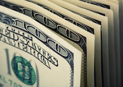 Closeup of $100 dollar bills in a row