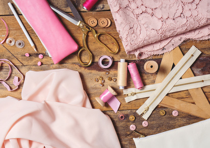 background with sewing tools and accesories